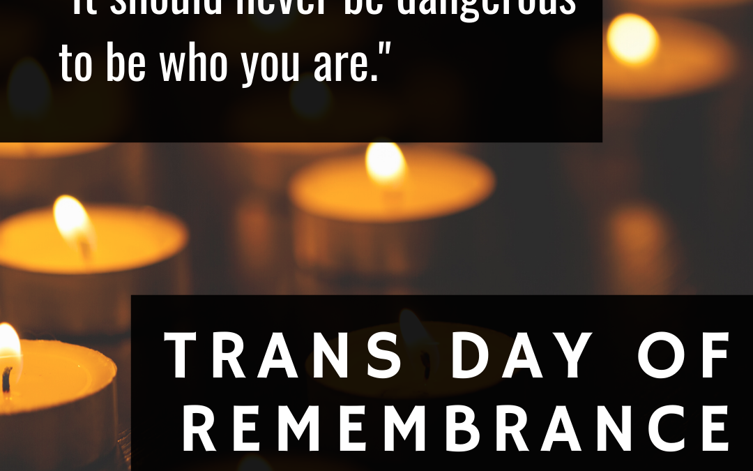 "Dim background with many small candles lit with text: ""It should never be dangerous to be who you are. Trans Day of Remembrance, November 20"
