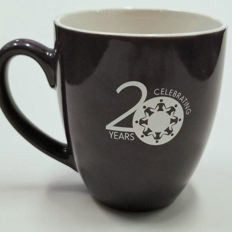 Purple mug with WCWRC's 20th anniversary logo